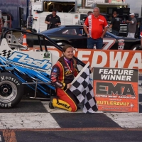 Jessica Bean poses in victory lane after winning Saturday night's USAC Speed2 Eastern Midget feature at Orange County Speedway in Durham, North Carolina.