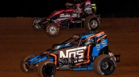 Chris Windom (bottom) takes the lead from Kyle Cummins (top) in the early stages of Friday's USAC AMSOIL National Sprint Car feature at Bloomington (Ind.) Speedway.