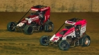 Kyle Larson (#86) battles Thomas Meseraull for the lead late in Saturday's Indiana Midget Week event at Lawrenceburg Speedway.