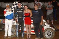 Shane Golobic celebrates after Saturday night's Honda USAC Western Midget victory at Placerville.