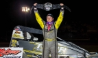 "Tyler Courtney holds the ""Sprint Car Smackdown VI"" champion belt after winning Saturday night's USAC AMSOIL National Sprint Car feature at Kokomo Speedway."