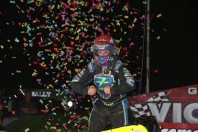 "Brady Bacon poses in victory lane after winning Thursday night's ""Eastern Storm"" opener at Grandview Speedway."