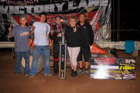 "Chris Windom and the Baldwin Brothers Racing crew celebrate Friday night's USAC AMSOIL National/CRA Sprint Car feature victory at Arizona Speedway's ""Western World Championships"" night one."