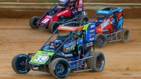 #39BC Cole Bodine tussles with #7BC Tyler Courtney and #9 Daison Pursley during 2020 USAC NOS Energy Drink National Midget action.