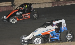 "Kyle Hirst (black) battles Ryan Bernal for position Saturday night in the ""Peter Murphy Classic"" at Tulare, California's Thunderbowl Raceway."