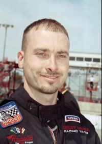 Dave Steele smiles for the cameras at Indiana's Winchester Speedway in 2003.