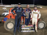 "Charles Davis Jr. is flanked by Mike Martin and Stevie Sussex after winning Saturday's ""Hank Arnold Memorial."""