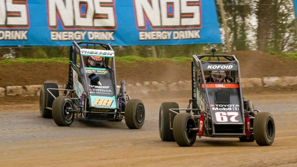 Winner Buddy Kofoid (#67) battles eventual runner-up Tanner Thorson (#88) for the lead in Saturday's USAC NOS Energy Drink National Midget opener at Bubba Raceway Park in Ocala, Fla.