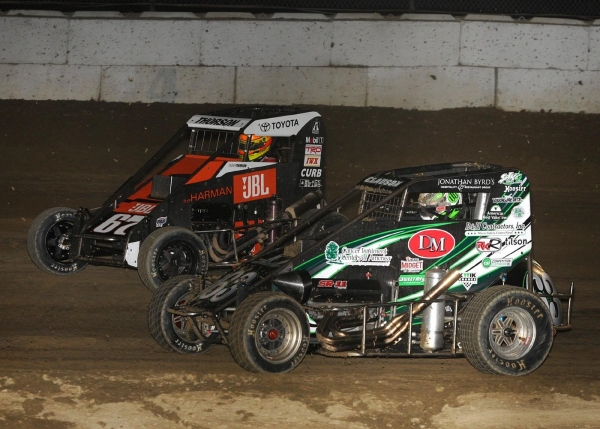 Bryan Clauson (#63) takes the lead from Tanner Thorson (#67) on his way to winning last Friday night's USAC Indiana Midget Championship feature at Plymouth (Ind.) Speedway.