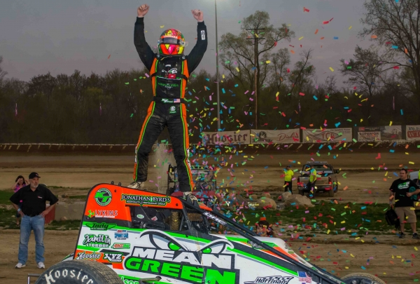 Kevin Thomas, Jr. cagestands after winning Saturday's USAC AMSOIL National Sprint Car feature at Plymouth (Ind.) Speedway.