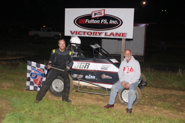 Andy Baugh and crew celebrates his USAC IMRA Midget win Saturday at Spoon River.
