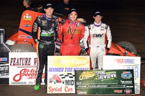 """Spring Showdown"" winner Chris Windom (middle) is joined by second-place finisher Chad Boespflug (left) and third-place finisher Justin Grant (right) in victory lane Saturday night at Tri-State Speedway in Haubstadt, Indiana."