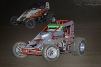 "Eventual winner Damion Gardner (silver #4) battles alongside Richard Vander Weerd for the lead in Saturday night's Budweiser ""Oval Nationals"" presented by All Coast Construction at Perris (Calif.) Auto Speedway."