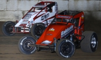 "Chris Windom and Chad Boespflug battle for the lead in Saturday night's ""Jim Hurtubise Classic"" USAC AMSOIL National Sprint Car feature at the Terre Haute (Ind.) Action Track."