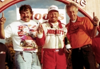 Jeff Walker (left), Tony Elliott (middle) and Joe Conroy (right) celebrate Elliott's USAC National Sprint Car championship at Winchester (Ind.) Speedway in 1998.