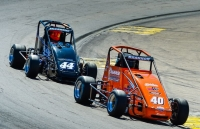 Blake Brannon and Tommy McCarthy in USAC Western HPD Midget action earlier in 2016.