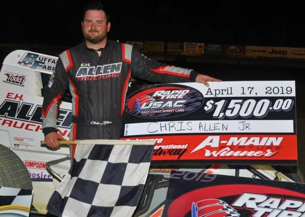Chris Allen, Jr. celebrates Wednesday night's USAC Rapid Tire East Coast Sprint Car feature at Delaware International Speedway.