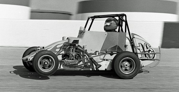 Tom Bigelow on the loud pedal at Indianapolis Raceway Park during his 1984 USAC National Midget championship season.
