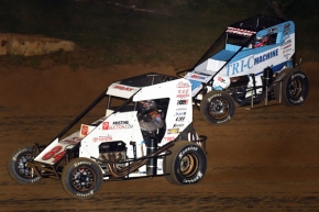 "#84 Chad Boat battles #3c Tanner Thorson for the lead during Thursday's ""Indiana Midget Week"" feature at Lincoln Park Speedway in Putnamville, Indiana."