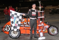 "Kyle Hamilton poses in victory lane after winning Saturday night's inaugural ""Tony Stewart Classic"" USAC Midget Special Event feature at the Lincoln Tech Indianapolis Speedrome."