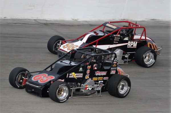 "#63 Kody Swanson battles #98 Chris Windom for position on his way to victory during Saturday night's ""Joe James/Pat O'Connor Memorial"" race at Salem (Ind.) Speedway."