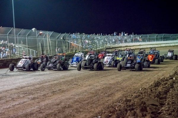 "The USAC AMSOIL Sprint Car field lines up for the feature during ""Winter Dirt Games"" in 2018 at Bubba Raceway Park in Ocala, Fla."