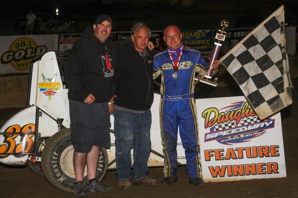 Davenport, Iowa's Davey Ray celebrates in victory lane with the crew after taking the feature victory in Saturday night's USAC Indiana Midget Championship race at Daugherty Speedway in Boswell, Indiana.