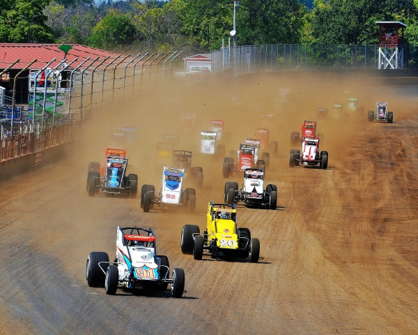 "Justin Grant leads the field at the start of the ""Bettenhausen 100"" at the Illinois State Fairgrounds in August."