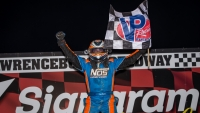Chris Windom celebrates his long-awaited first career USAC NOS Energy Drink National Midget win Saturday at Lawrenceburg Speedway.