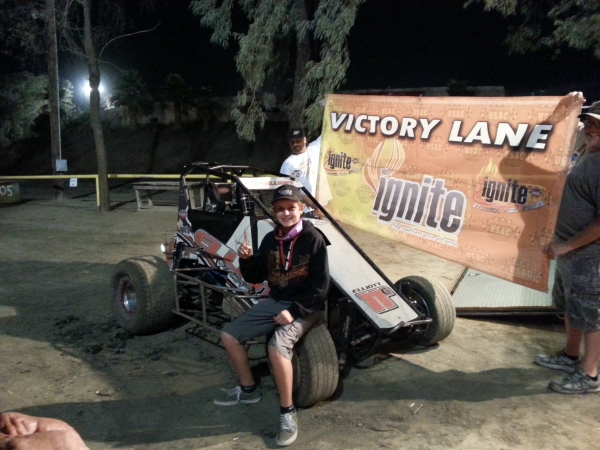 Cory Elliott poses after Bakersfield victory, claiming the 2013 Dirt title..