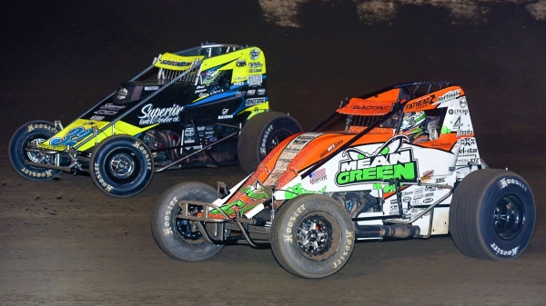 Brady Bacon (#69) & Chase Stockon (#32) race side-by-side.