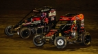 Jason McDougal (#76m) goes wheel-to-wheel with Kevin Thomas, Jr. (#5) for the lead in Saturday night's Harvest Cup at Tri-State Speedway in Haubstadt, Indiana.