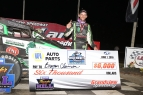 "Bryan Clauson enjoys the spoils of victory (and the big check) in victory lane after winning Tuesday night's ""Jesse Hockett Classic"" - ""Eastern Storm"" opener at Bechtelsville, Pennsylvania's Grandview Speedway."
