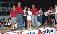 Billy Boat (third from left) and John Lawson (on right in red shirt) celebrate in victory lane after winning a USAC National Midget feature at Indiana's Terre Haute Action Track in 1997.