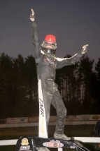 Adam Pierson, with one finger on each hand raised in salute, acknowledges his USAC record-tying 11th consecutive DMA Midget victory Saturday at Bear Ridge.