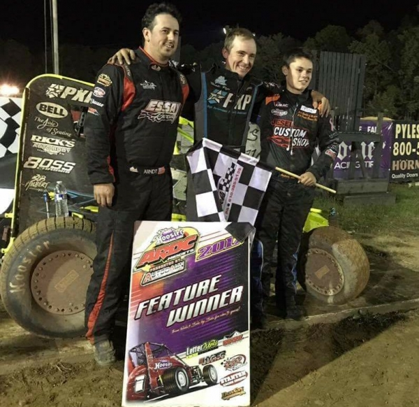 Alex Bright (middle) is joined in victory lane by 2nd place finisher Andrew Layser (right) and 3rd place finisher Brett Arndt (left).