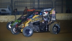 Cannon McIntosh (#71K) & Cole Bodine (#39BC) battle in March USAC NOS Energy Drink National Midget action.