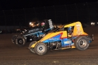 Josh Hodges (yellow) and C.J. Leary battle for position at Gas City.