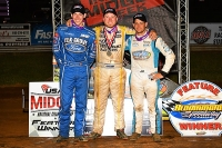Clauson-Marshall Racing teammates Shane Golobic (3rd), Tyler Courtney (1st) and Justin Grant (2nd) celebrate in victory lane Friday night at Bloomington Speedway.