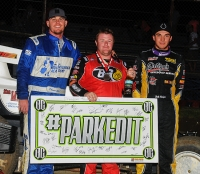 Winner R.J. Johnson is flanked by Josh Hodges and Dennis Gile after his win at Creek County.