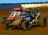 "#16 Austin Nemire battles #24 Mike Haggenbottom during last year's ""Sumar Classic."""