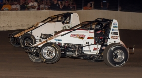"Kyle Cummins (inside) battles Tyler Courtney (outside) for the lead during Saturday night's USAC AMSOIL National Sprint Car ""Haubstadt Hustler"" at Tri-State Speedway in southwestern Indiana."