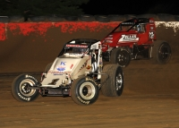 "Robert Ballou (#1) passes Thomas Meseraull (#66) for the race lead during Wednesday night's ""Tony Hulman Classic"" feature at the Terre Haute (Ind.) Action Track."