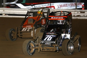 "Brady Bacon (#76m) and Tanner Thorson (#67) battle for the lead during ""Jason Leffler Memorial"" at Wayne County Speedway in October."