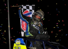 "Thomas Meseraull celebrates following his victory in Tuesday night's NOS Energy Drink ""Indiana Sprint Week"" race at Kokomo Speedway."
