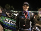 "Tristan Guardino poses in victory lane after winning Wednesday night's USAC West Coast Sprint Car ""Turkey Night Grand Prix"" preliminary feature."