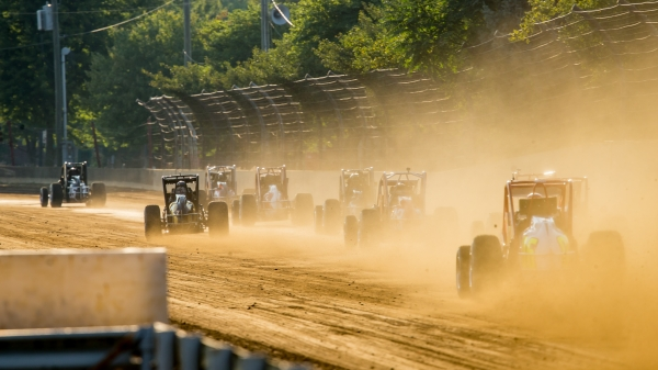 USAC Silver Crown cars roar down the back straightaway at the Indiana State Fairgrounds in 2020.