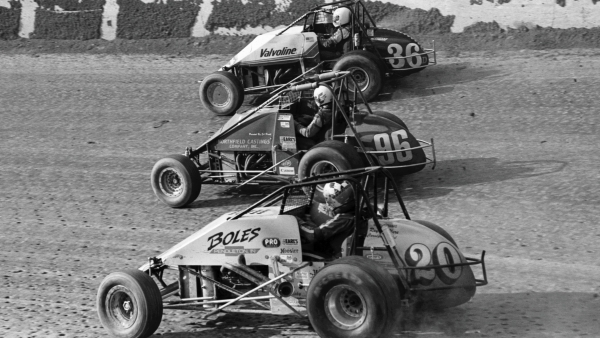 Kevin Doty (#20), Chip Thomas (#96) and Dave Darland (#36D) three-wide at Eldora Speedway in 1994.