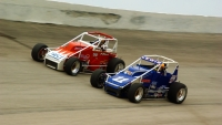 #11 Michael Lewis and #29 Bud Kaeding battle at Winchester (Ind.) Speedway in 2003.