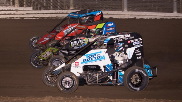 Three-wide with the USAC NOS Energy Drink National Midgets at Merced (Calif.) Speedway in 2020.